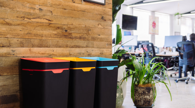 How does your company feel about our planet's flowerpot, plant, recycling bin, room, tree, wall, waste container, waste containment, white, orange