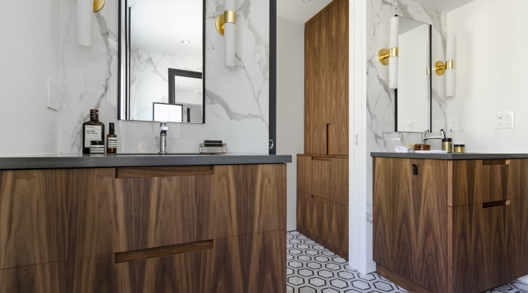 A floor to ceiling pocket door allows privacy