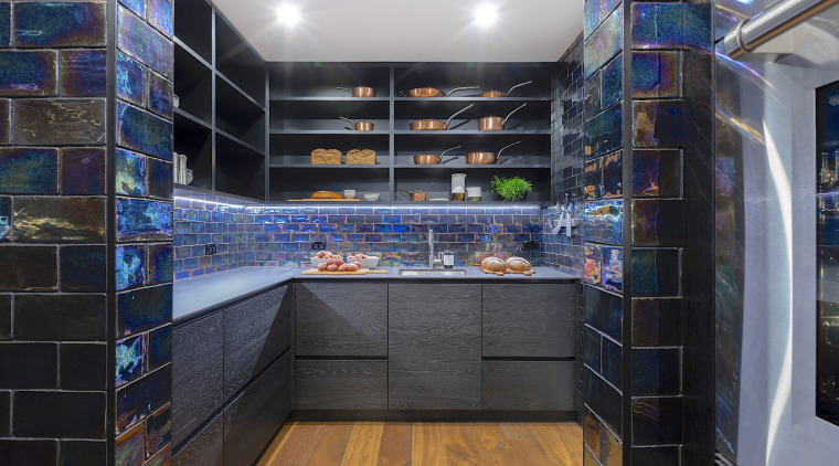 This kitchen was expanded by repurposing an adjacent black, gray