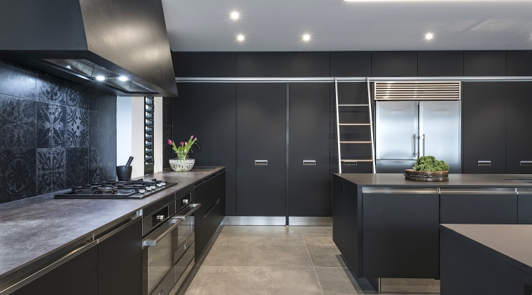 Tall order? Capacious storage climbs to the ceiling black, gray