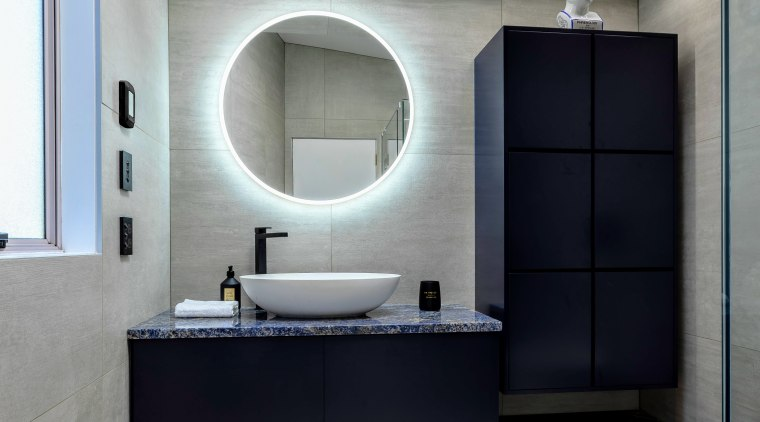The owners wanted to renovate the ensuite in bathroom, bathroom accessory, bathroom cabinet, interior design, room, sink, gray, black