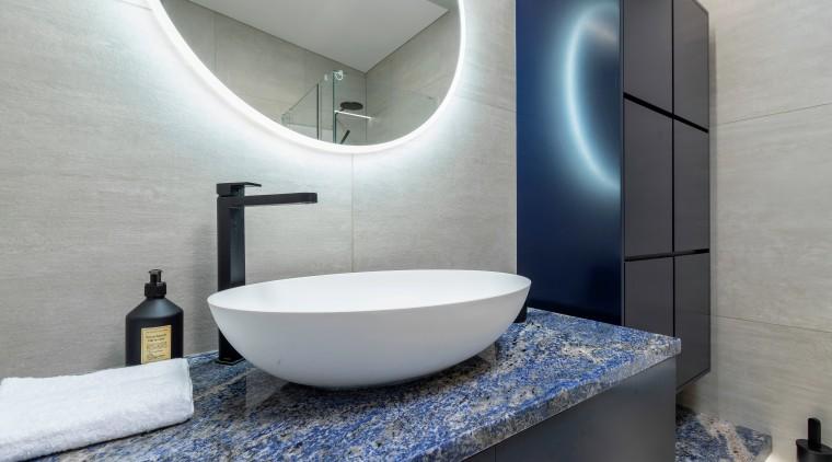 The vanity was further enhanced with an oversized bathroom, bathroom accessory, bathroom sink, ceramic, floor, interior design, plumbing fixture, room, sink, tap, tile, toilet seat, gray