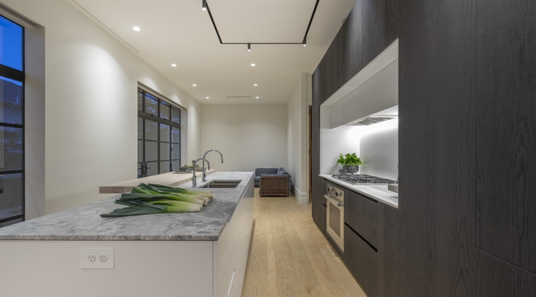 Wood, white and white granite combine to optimum apartment, architecture, building, cabinetry, ceiling, countertop, daylighting, design, floor, flooring, furniture, green, home, house, interior design, kitchen, light fixture, lighting, loft, property, real estate, room, table, wall, gray, black