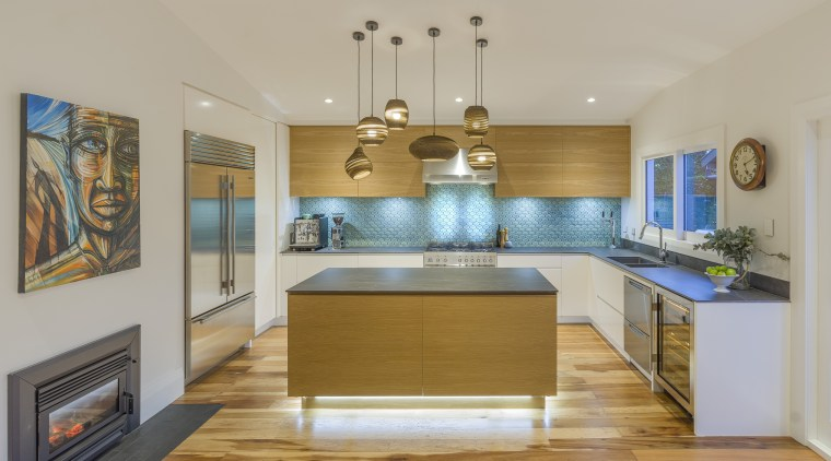 ​​​​​​​The iridescent splashback draws the eye in this architecture, building, cabinetry, ceiling, countertop, dining room, estate, floor, flooring, furniture, hardwood, home, house, interior design, kitchen, light fixture, property, real estate, room, wood, wood flooring, yellow, gray