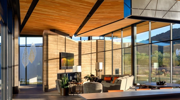 This central atrium-like space receives plenty of natural architecture, ceiling, daylighting, house, interior design, real estate, roof, window, brown
