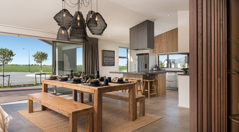 ​​​​​​​This generous family-dining-kitchen area in a GJ Gardner gray, brown