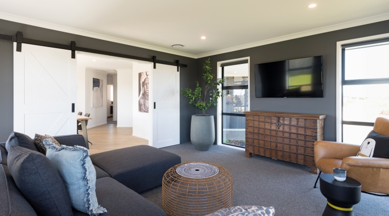 The living room is a few steps from apartment, building, coffee table, den, floor, furniture, home, house, interior design, living room, property, real estate, room, table, white