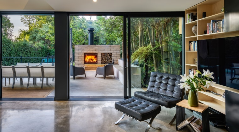 The double height living room looks out on