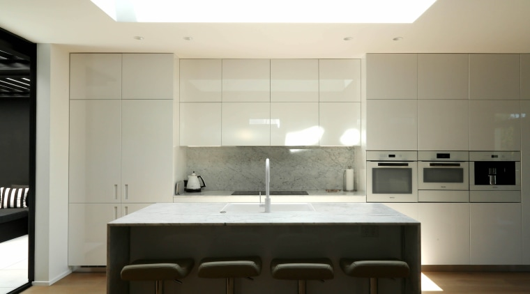 A picture in white (and veined marble), this architecture, building, cabinetry, ceiling, countertop, cupboard, design, floor, flooring, furniture, home, house, interior design, kitchen, light fixture, lighting, material property, property, room, table, white, gray
