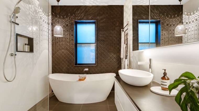 Modern and eye-catching, the main bathroom features table-top architecture, bathroom, bathtub, building, ceiling, floor, flooring, home, house, interior design, plumbing fixture, property, real estate, room, sink, tap, tile, wall, gray, brown