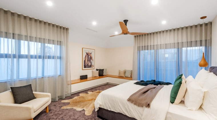 The first floor features a large main bedroom bed, bed frame, bed sheet, bedding, bedroom, boutique hotel, building, ceiling, comfort, curtain, floor, furniture, house, interior design, mattress, mattress pad, property, real estate, room, suite, textile, wall, window covering, window treatment, white