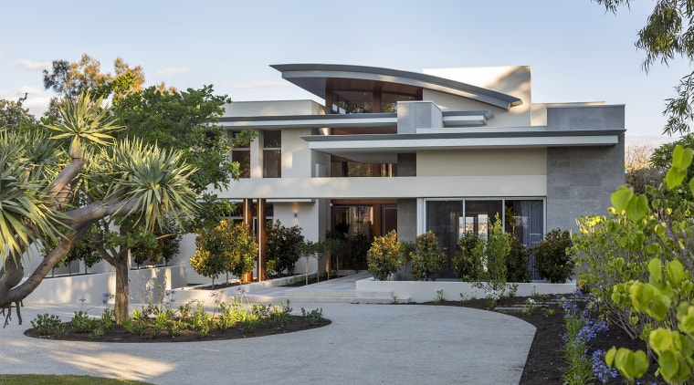 A contemporary facade reveals glimpses through to the architecture, building, estate, facade, home, house, interior design, mansion, official residence, property, real estate, residential area, roof, tree, villa, white, gray