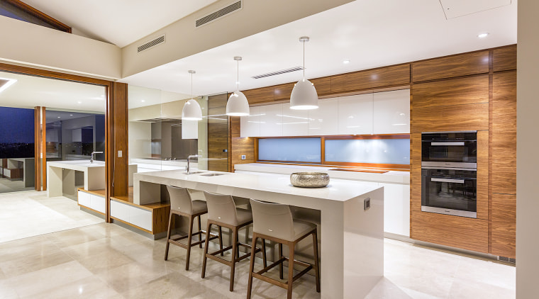 A state-of-the-art kitchen for a state-of-the-art home by architecture, building, cabinetry, ceiling, countertop, design, dining room, floor, flooring, furniture, home, house, interior design, kitchen, property, real estate, room, table, tile, gray