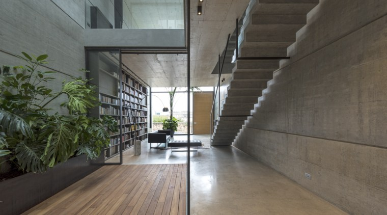 The ground floor library area looking one way architecture, building, ceiling, concrete, daylighting, floor, flooring, hall, hardwood, home, house, interior design, laminate flooring, lobby, loft, property, real estate, room, stairs, wall, wood, wood flooring, gray, black