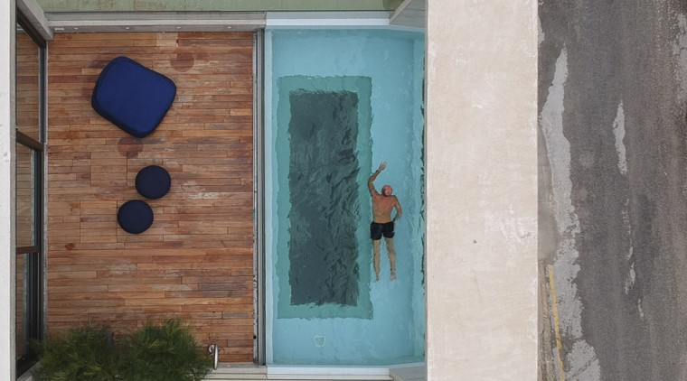 A bird's eye view of Casa B's top-level blue, door, green, turquoise, wall, window, wood, gray, landscaping, rooftop pool