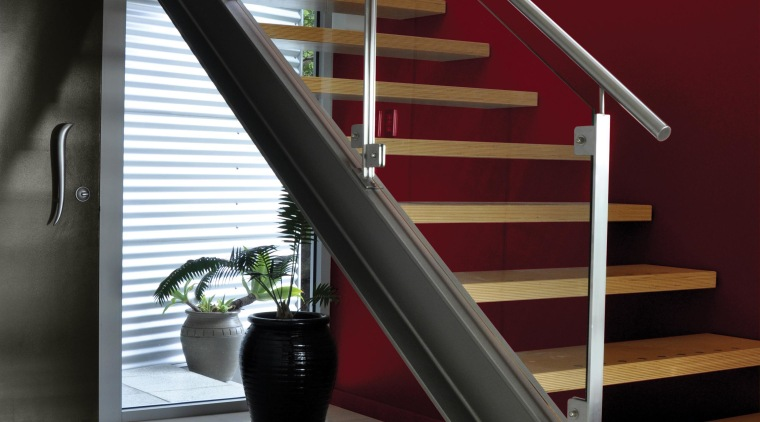 Feature wall using moody red architecture, baluster, floor, glass, handrail, interior design, stairs, red, gray