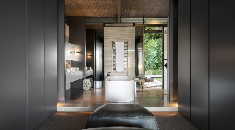 In this renovated master suite, the new bathroom architecture, interior design, black, gray