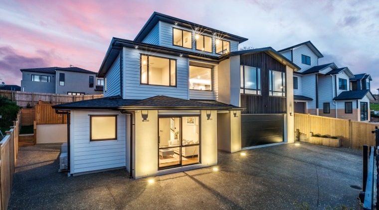 This high-end Albany showhome by Chancellor Construction is facade, home, house, property, real estate, residential area, siding, window, Sang Architectural Design, Elite North Harbour, Cove Lighting