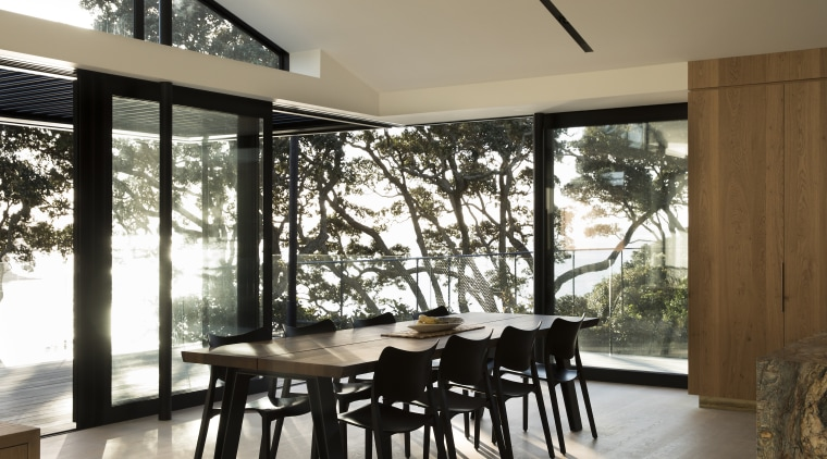 As with other interior elements on this renovation, architecture, dining room, furniture, house, interior design, property, real estate, table, window, white