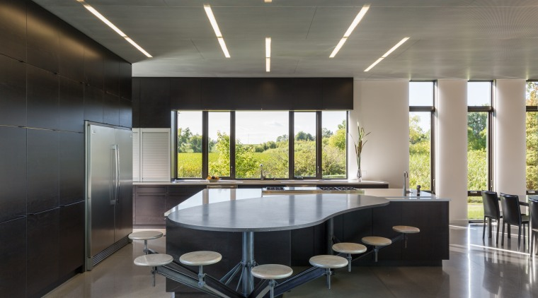This kitchen's informal seating area is shaped to architecture, interior design, custom table, Altus Architecture