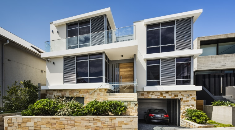 Clean-lined and contemporary, with a base of natural architecture, building, elevation, facade, home, house, neighbourhood, property, real estate, residential area, window
