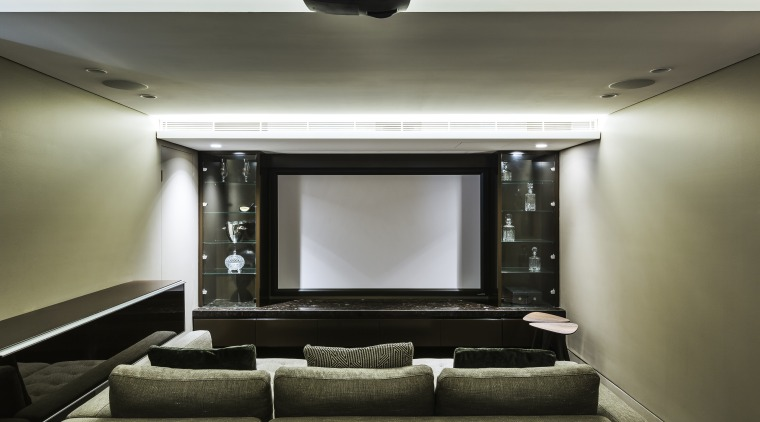 ​​​​​​​The lower ground floor of this home by interior design, home theatre,  Giles & Tribe Architecture