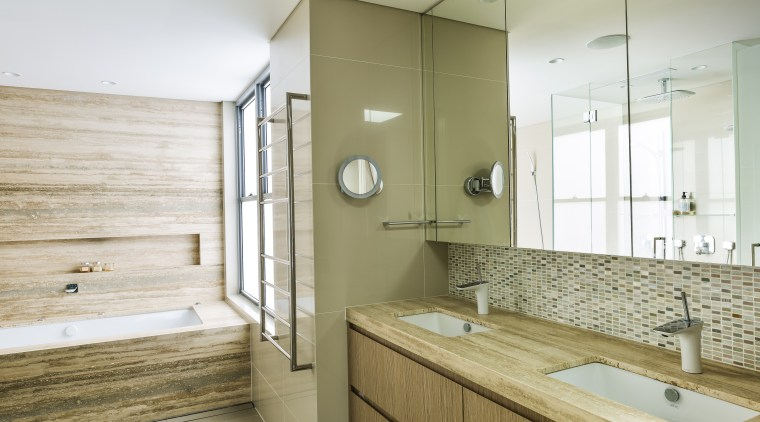 ​​​​​​​The ensuite cabinetry in this master suite continues architecture, bathroom, home, bathroom design, white, master suite, timber cabinetry, wood, timber, travertine, Giles & Tribe Architecture