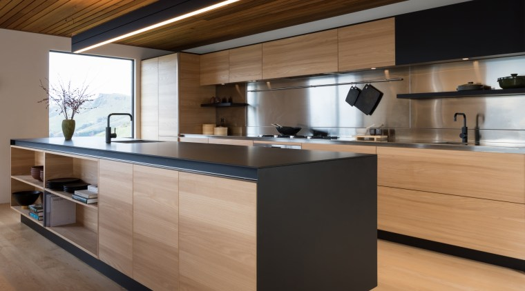 Sleek new kitchen has both a clean-lined design architecture, cabinetry, countertop, cuisine classique, floor, flooring, hardwood, interior design, kitchen, laminate flooring, plywood, wood, wood flooring, brown