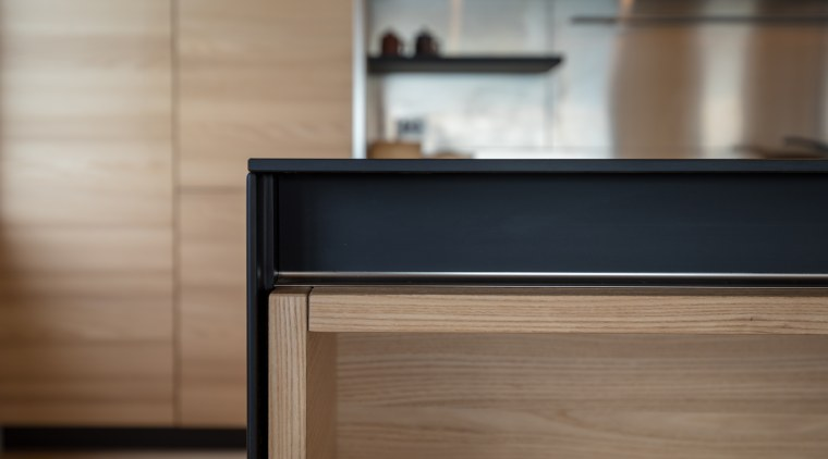 Negative detail cabinetry pulls contribute to the minimalist drawer, floor, furniture, hardwood, wood, wood stain, brown