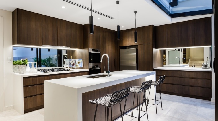 Mirror splashbacks add to the sense of space cabinetry, countertop, cuisine classique, interior design, kitchen, white, black