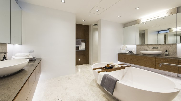In this master ensuite, oval countertop basins on bathroom, floor, interior design, real estate, room, sink, gray