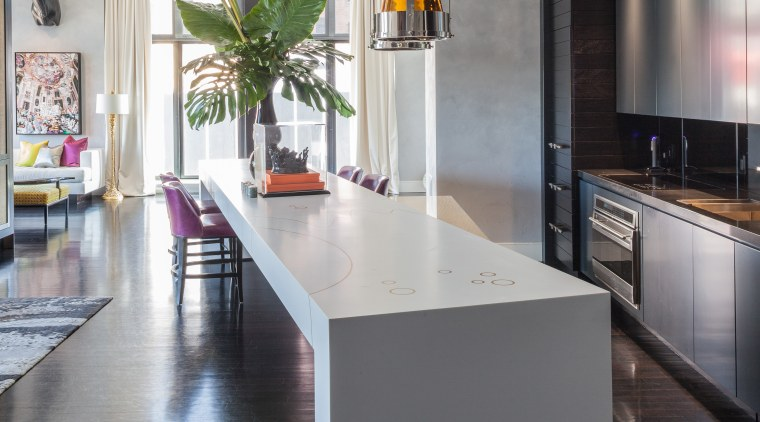 This Corian counter angles away from the kitchen, countertop, cuisine classique, floor, flooring, interior design, kitchen, loft, table, gray