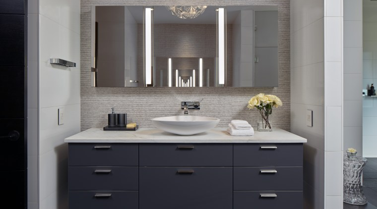 ​​​​​​​Set directly opposite each other, the wall-hung, mirror-fronted bathroom, bathroom accessory, bathroom cabinet, cabinetry, countertop, floor, interior design, kitchen, room, sink, gray, black
