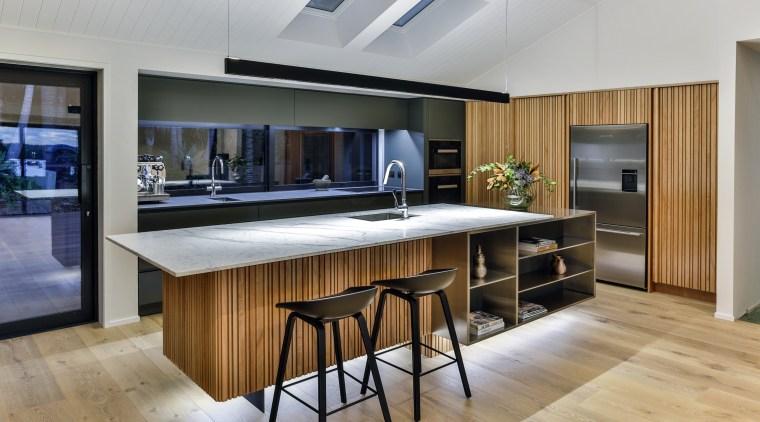 This entertainer's kitchen by Fyfe Kitchens designer Kira countertop, floor, flooring, interior design, kitchen, real estate, gray