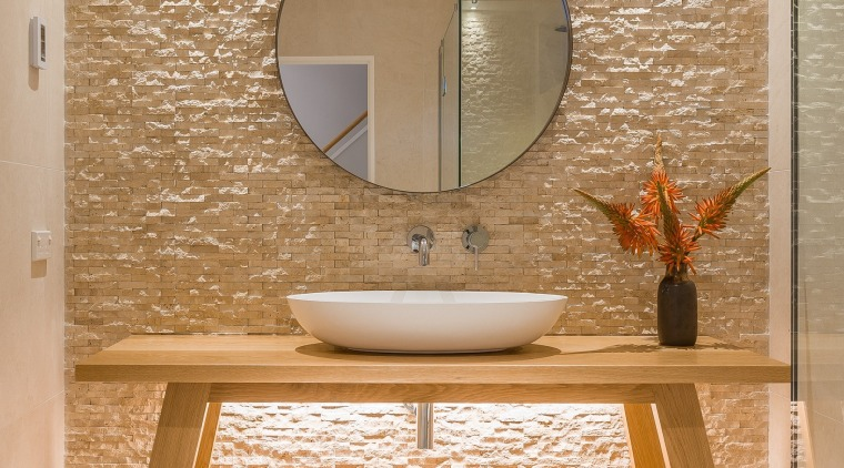 ​​​​​​​Symmetry plays a major role in creating a  architecture, bathroom, flooring, interior design, plumbing fixtures, sink, tap, tiles, Resene, Natalie Bu Bois, tapware, travertine