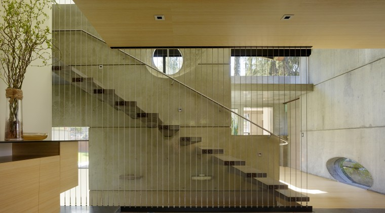 Just inside the entrance to this home, the architecture, baluster, ceiling, daylighting, glass, handrail, house, interior design, lobby, stairs, brown, gray