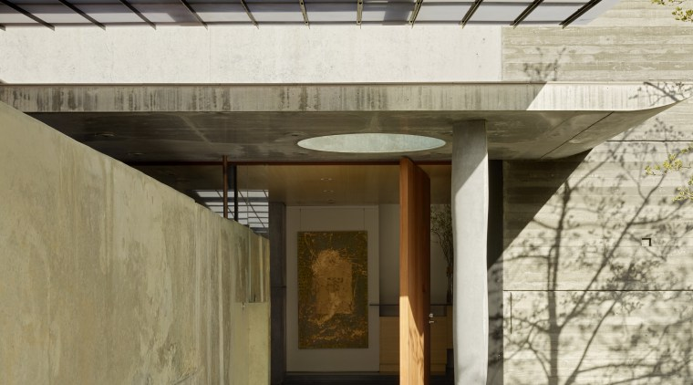 The structural column at the entrance to this architecture, daylighting, house, roof, gray, brown