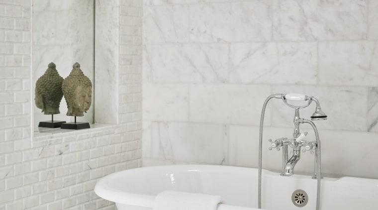 The bath tub in this new master suite bathroom, ceramic, flooring, home, plumbing fixture, tap, tile, freestanding bath, master site, tiles, Mark Williams Design