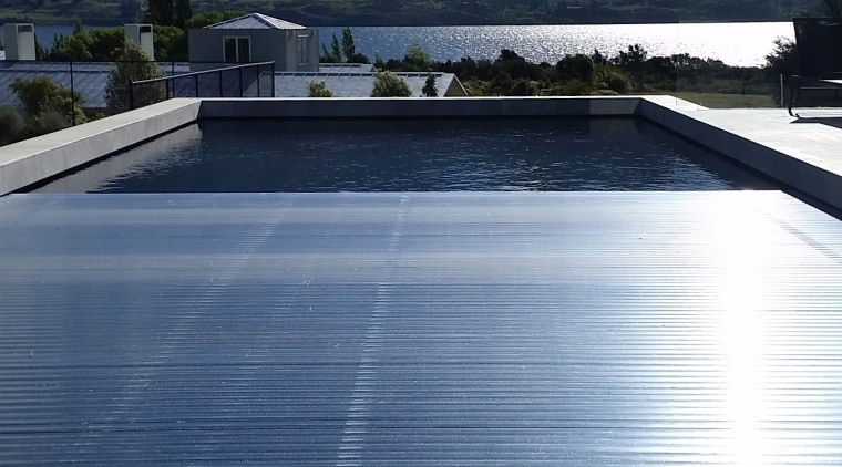 ​​​​​​​Roll Out Roll Under slatted covers are a reflection, reservoir, water, covers 4 pools, swimming pool