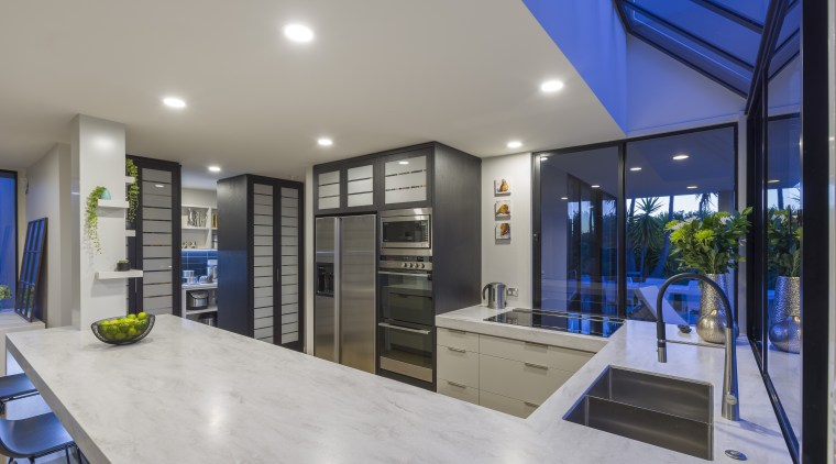 ​​​​​​​Two pantries for food and crockery flank the house, home, kitchen design, Kira Gray, Fyfe Kitchens, cabinetry, Corian benchtop