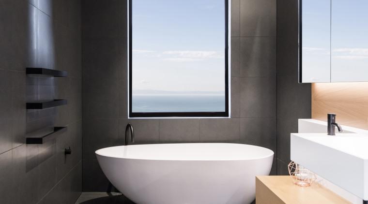 For this bathroom by designer Davinia Sutton, shapes architecture, bathroom, floor, flooring, interior design, tile, gray, black, Freestanding bath, Davinia Sutton