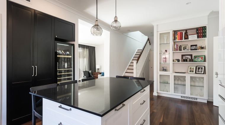 ​​​​​​​When doors open to your kitchen from all cabinetry, countertop, interior design, kitchen, IL Design, cabinetry, black, white, ceasarstone, timber flooring, open shelving