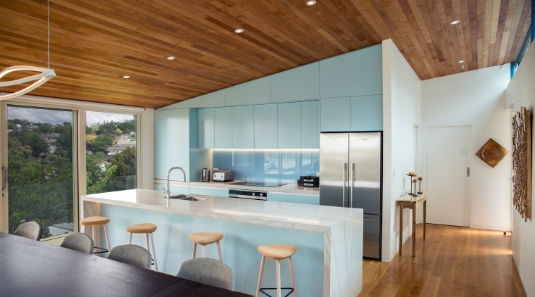 Finished in powder blue and defined by the architecture, ceiling, countertop, floor, house, interior design, table, wood, gray, brown, timber floor, Frans Kamermans