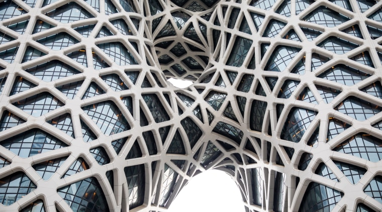 Net outcome – sculptural voids punctuate the Morpheus architecture, building, daylighting, line, material, metal, metropolis, pattern, structure, symmetry, white, gray, black