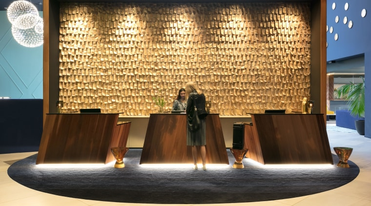 A wall sculpture of gold leaves – evoking furniture, interior design, table, orange, brown