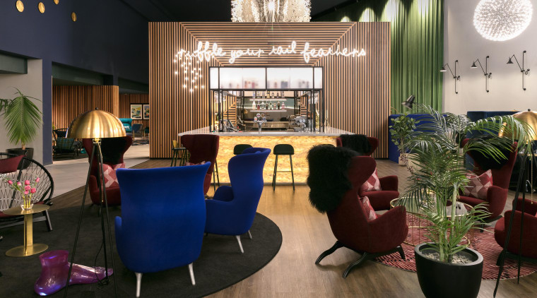 The back-lit onyx bar is set against the interior design, living room, lobby, room, black