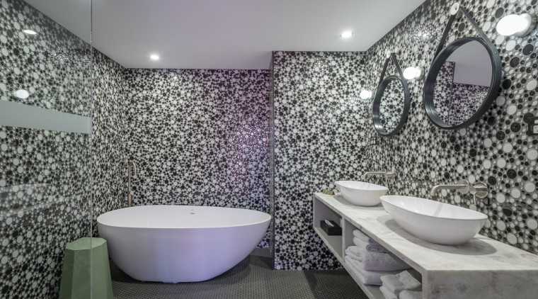 Japanese artist Yayoi Kusama's dotted surfaces installations provided architecture, bathroom, ceramic, floor, flooring, interior design, property, purple, room, tile, wall, gray
