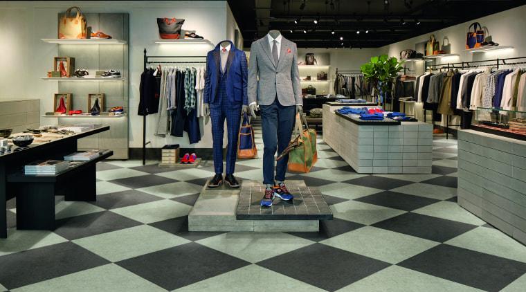 The biggest surface area in the room, retail boutique, floor, flooring, interior design, retail, black, gray