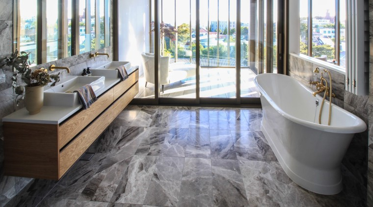 A freestanding tub and stone floors and walls bathroom, flooring, home, interior design, laminate flooring, bathroom, tile, Dominion Constructors