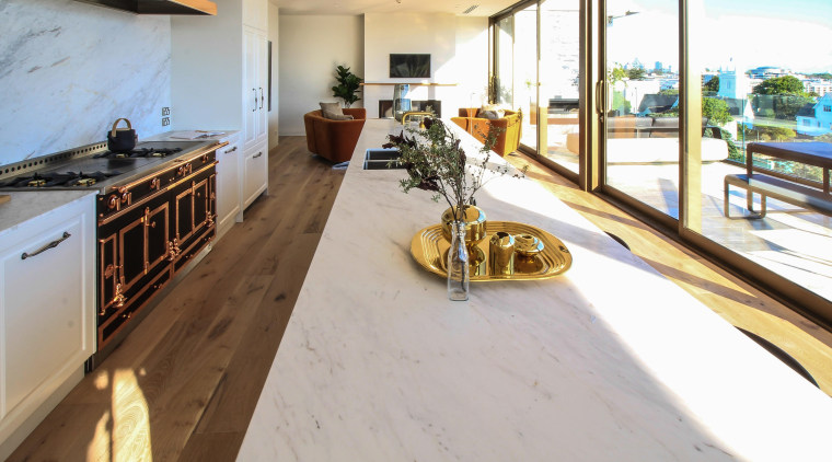Classic materials and high-end appliances are all features flooring, hardwood, apartment, wood, wood flooring, kitchen, marble island, Dominion Constructors
